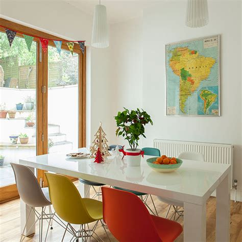 dining room with multi coloured chairs decorating