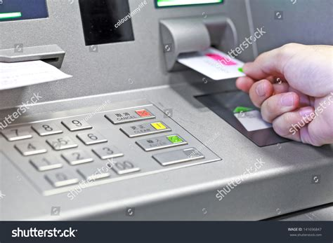 how bank make profit from credit card inserting atm credit card into stock photo 141696847