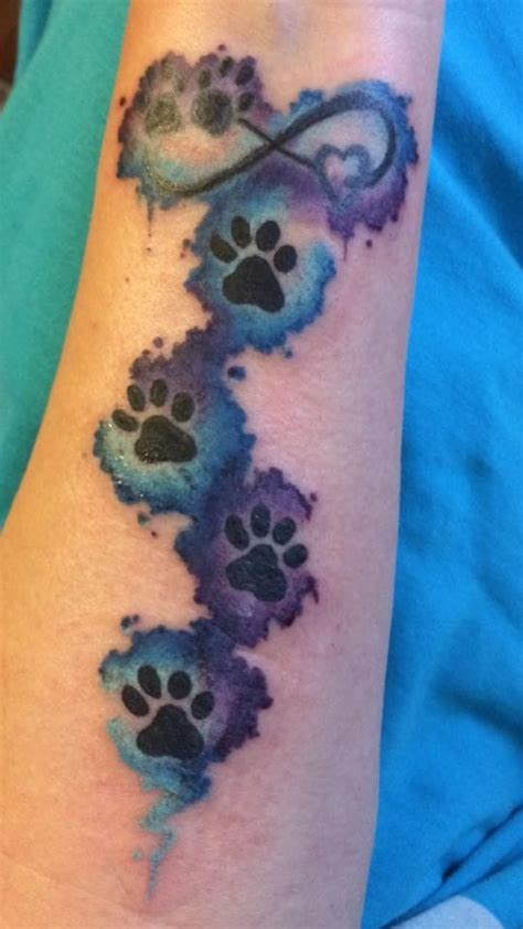 animal wrist tattoos paw print infinity water color blue turquoise purple