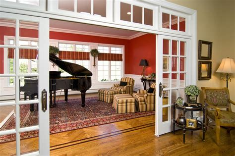 how to divide a room glass doors and transoms divide the space but keep the rooms light and bright