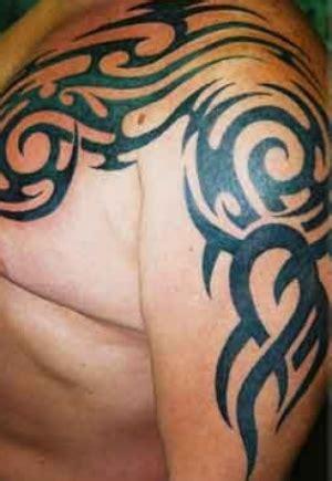 tribal roses tattoo on biceps tattooshunt com tribal arm n chest for tattooshunt