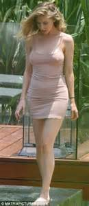 In a skimpy dress in thailand on holiday with her extended family