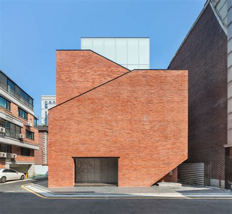 Uncommon Recording Studio Design in Seoul Dressed in Brick