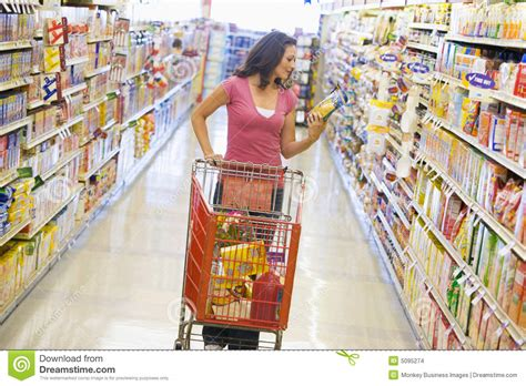 woman shopping in supermarket aisle stock images image
