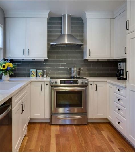 small white kitchen with steel hood stainless chimney range hood white kitchen cook