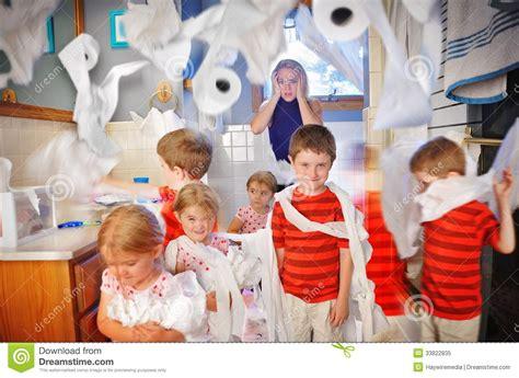 stress mother watching kids   mess stock image