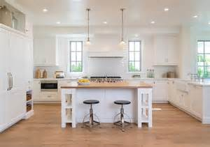 white kitchen island with seating kitchen peninsula with pass through and glass front