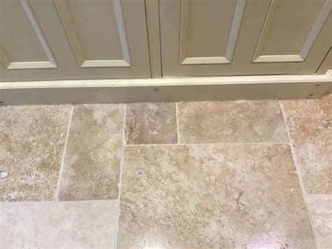 dealing with a pitted travertine tiled floors