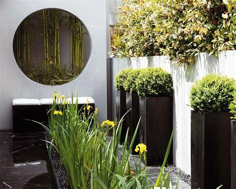 chimenea jardín exterior hachup salon comedor con estilos moderno y rustico