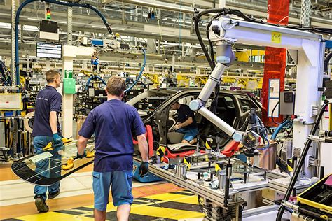 bmw factory robots bmw shows fancy robots in its factories humans
