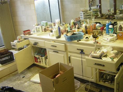 cluttered bathroom organizing your bathroom often requires a big purge san diego professional organizer