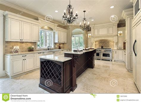 Upscale Dining Room Furniture by Kitchen With Double Deck Island Royalty Free Stock Photo