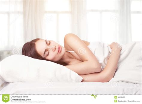laying down in bed beautiful woman lying down in bed royalty free stock