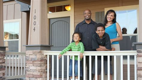 buying a house with family happy african american family buy a house stock footage video 4681370 shutterstock