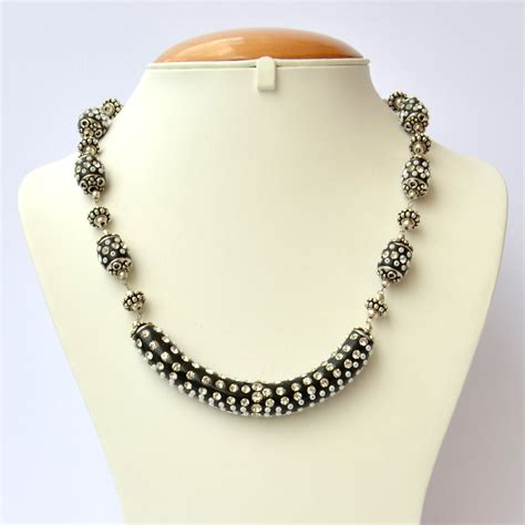 black handmade necklace studded with seed