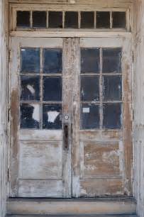 Old And Vintage Exterior Double Wood Doors With Glass Door Lites Frames