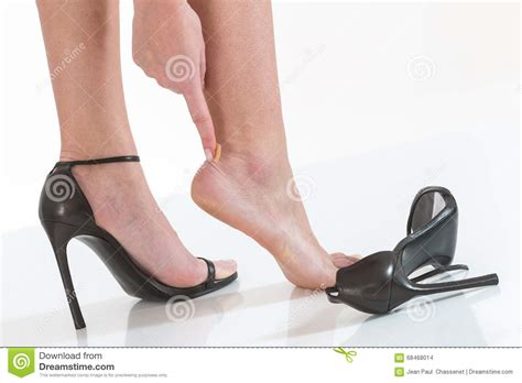 in after wearing high heeled shoes stock