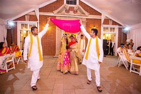 Indian Groom Makes Dramatic Entrance by Outdoor Holud Ceremony Captured By Lovesome Photography