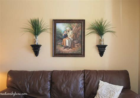 Living Room Wall Hangings | hanging wood trim in my living room