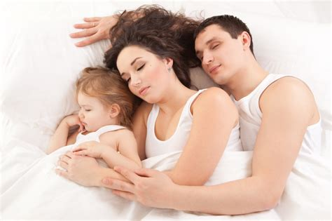 How To Get Babies To Sleep In Their Crib by Should You Bring Your Baby Into Bed Today S Parent