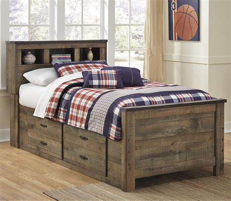 twin bed with storage underneath signature design by ashley trinell rustic look twin