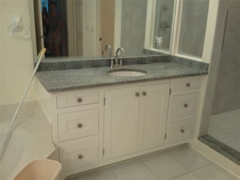 custom built alabaster white vanity cabinets