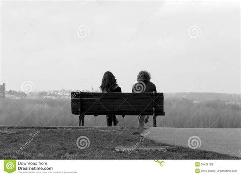 two people sitting on a bench long view royalty free stock images image 30426129