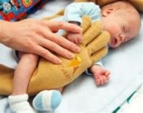 comfort nursing newborn the zaky hand a therapeutic pillow for nicu babies