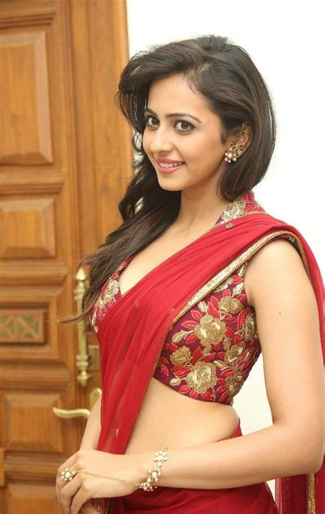 Home Blue October Lyrics by Rakul Preet Singh In Red Saree Latest Photos Hd Stills
