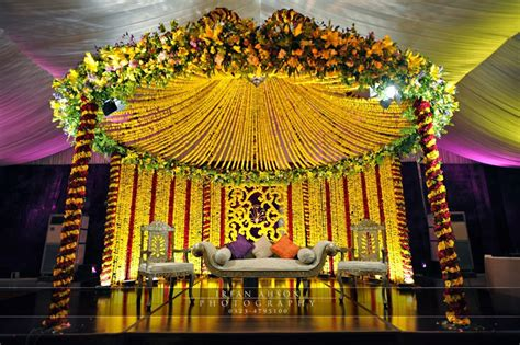 Simple Mehndi Stage Decoration by Pre Wedding Mehndi Of Popular Singer Atif Aslam And