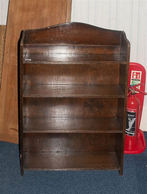 small oak bookcase with 4 shelves height 40 inches 27 x 7