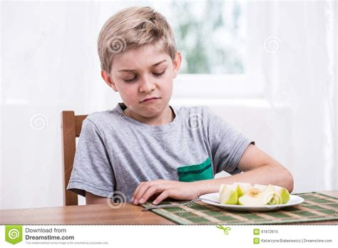 a fruit that doesn t an a in it boy doesn t like fruit stock photo image 61872615