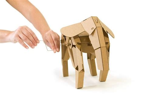 kinetic creatures bring cardboard animals to life