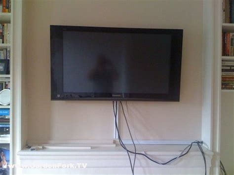 hanging a tv on brick fireplace hang a tv on a brick or concrete wall gardenfork tv