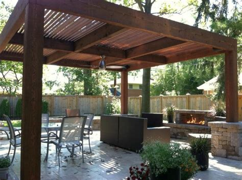 simple modern pergola kit with outdoor fireplace