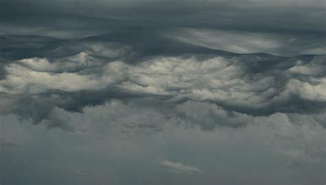 Beneath Clouds Essay by Into The Clouds Fourwindowspress