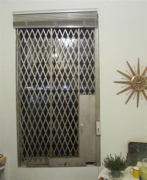 Security For Apartment Windows Is It Possible To Paint An Accordion Style Security Gate
