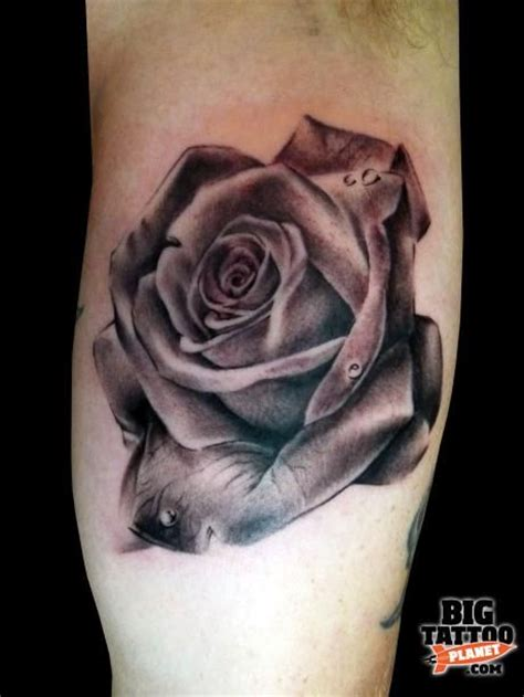 large rose tattoo and gray big tattoos