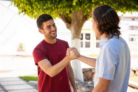friends greeting each other stock photo 169 tonodiaz 72580893
