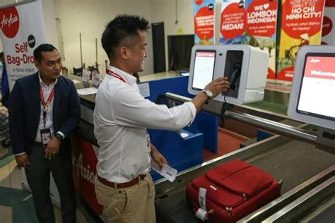 airasia early check in airasia passengers need to drop their bags 4 hours before