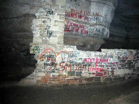 spray painter lecturer the large entrance area of the cave was more thanle for