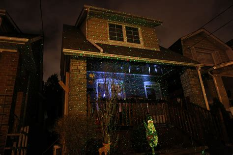 christmas lights projected on house projection spotlights illuminate neighbourhoods ahead of the holidays toronto