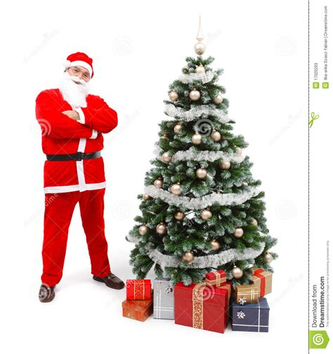 santa claus with tree images santa claus standing near tree stock photos image 17020293