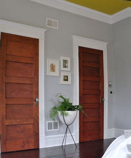 the baseboards and trim around the doors and the crown molding i like white doors better