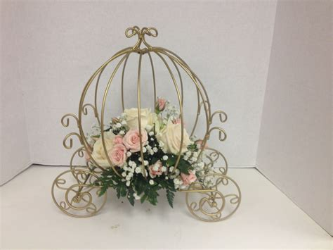 carriage centerpieces with cream and pink roses wedding