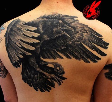 raven tattoo on neck amazing raven tattoo design best tattoo 2015 designs