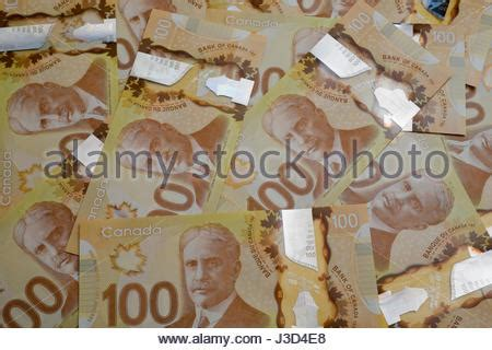 composition of dollar bill canadian 100 one hundred dollar bills paper money held in