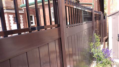 vinyl wood fence with wrought iron toronto vinyl fence