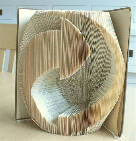 Paper Folding Breaker - this secondhand store volunteer s book folding will
