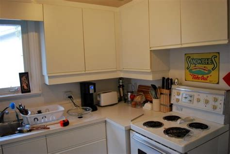 ugly kitchen cabinets painting melamine cabinets with oak trim cabinets matttroy